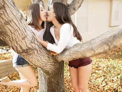 Gia Paige and Jenna Sativa enjoy romance in the fall, chasing each other around a tree. Their play gets increasingly naughty as they shower each other's bottoms with leaves. Eventually they exchange a kiss through the tree's branches and then take things inside.Climbing into bed together, they continue to exchange deep kisses as their hands wander each other's tight bodies. Jenna loves the feel of Gia's breasts beneath her soft palms, especially once the brunette's bra is but a memory. Next she peels off Gia's panties and shares a taste of the musky fabric with her lover. Only then does she kiss her way down Gia's body and start lapping away at Gia's landing strip twat with her soft tongue.Turning the tables on her lover, Gia flips Jenna over onto her back so that she can relieve her of her shorts. From there one look at Jenna's smiling face as she squeezes her own nipples is enough to practically make Jenna cum again. She takes a few moments to suckle Jenna's pussy, but Jenna has salacious plans that don't involve being a passive observer.Propping Gia up onto her knees, Jenna dives back into her lover's pussy. The position easily opens Gia's snatch for Jenna's pleasure, but it's not quite what either girl is looking for. The solution is a 69 where Gia lays on the bottom while Jenna flattens herself on top. This way they can both get what they want: plenty of time to lick and suck each other's fuck holes.The moment Gia comes apart beneath Jenna's touch, Jenna knows just what she wants to do. She rises up so that she is in a seated position, making it easier than ever for Gia to work her mouth up and down her landing strip snatch. Jenna is so turned on that it doesn't take much effort on Gia's part to help her lover reach the grand finale. As Jenna keeps on shuddering her ecstasy, she moves back so that the girls can each suckle one another's breasts. That is the perfect foreplay to a bit of mutual light masturbation, a sultry way to come down from their lovemaking extravaganza.
