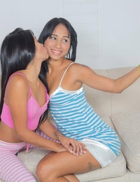 Amateur coeds Ambar Suarez and Sofia Suarez cuddle on the couch while taking selfies, and then move on to kissing while admiring each other's hot tight bodies. Ambar is the first to start peeling off her clothes and the first to lose her thong. Soon she is leaning forward so that Sofia, also down to just her thong, can bury her fingers and face in her lover's greedy bald twat.Swapping spots, Ambar settles between Sofia's thighs and puts her clever tongue to work lapping at Sofia's soft bare pussy. She replaces her tongue with her fingers, working them in a come-here motion that drives Sofia wild with passion. It's not long before the horny Latina is moaning in absolute sexual bliss.Sofia isn't done making Ambar scream despite both of their total satisfaction. Pulling out a vibrating toy, Sofia shows Ambar how to suck it off and then demonstrates the deep pleasure it can bring by caressing it over Ambar's tender clit. Now that Ambar has had a taste, she needs to press the toy to Sofia's snatch as her lover assumes the doggy style position and lets the deep pleasure wash over her one last time as her hips bump and grind.