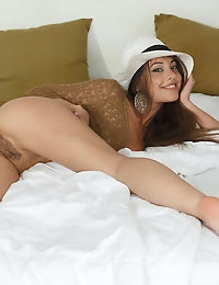 Lorena B flashes a seductive smile as she pleasures herself in the butt