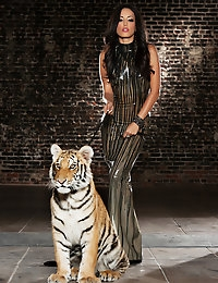 Penthouse Pet Layla Sin poses with a tiger and then plays.