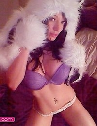 Angelina Stevens in purple lingerie and gloves